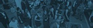 A blue filtered photo of alumni dancing during Black Alumni Weekend