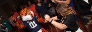 Aubie dancing with Alum