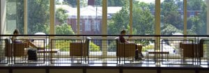 Scholarship-header, students sitting on third floor of the AUSC, studying