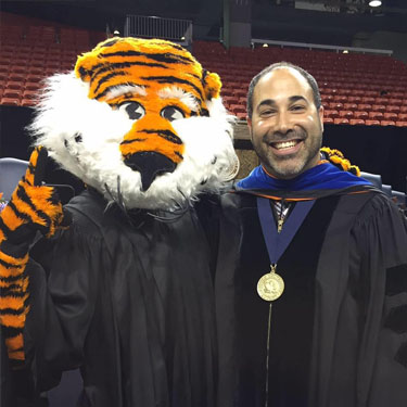 Jason Bryant Featured - Aubie and his medallion