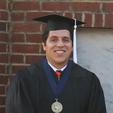 Joel Alvarado featured - wearing his medallion