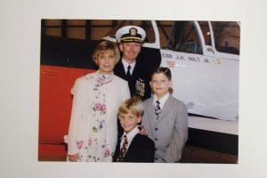 Auburn grad Jim Holt in dress blues with his children and wife, Jan, who is also an Auburn alumni.