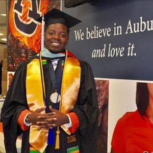 Wade Manora and his medallion at graduation