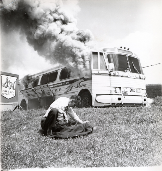Choking on smoke from an attacker's incendiary device, Anniston 1961