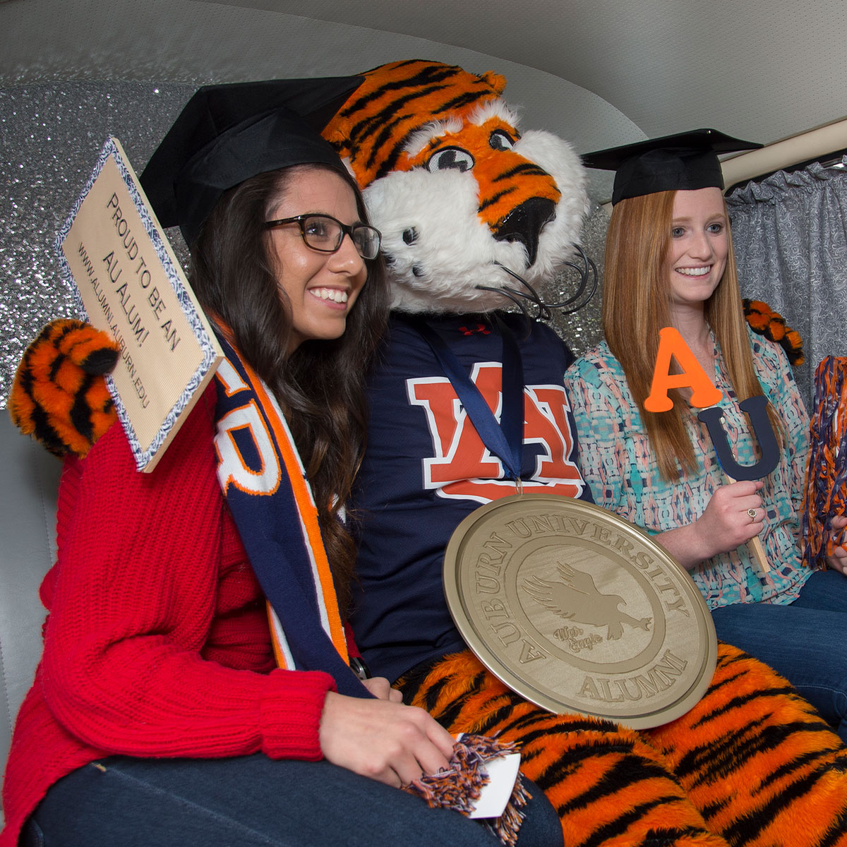 Aubie posing with medalion