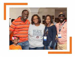 A Family of 5 stand and poses for a picture at Black Alumni Weekend 2016