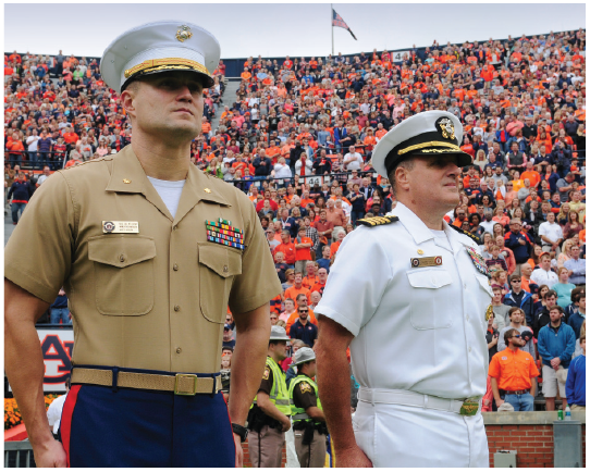two military men at football game