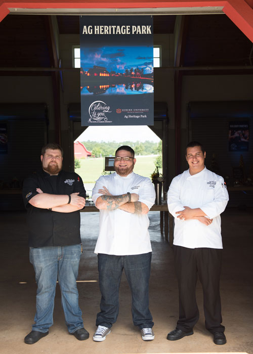 Chef Leo and two other chefs standing in a barn