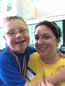 Tori Allen holding a child at the Special Olympics