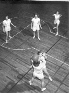 5 women playing basketball