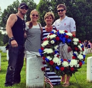 Sarah White, her family, and country singer Brantley Gilbert stand by Captain White's grave