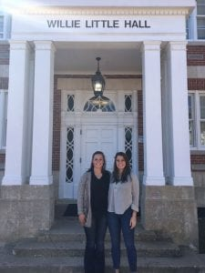 Catherine and Emma Clark standing in front of Willie Little Hall