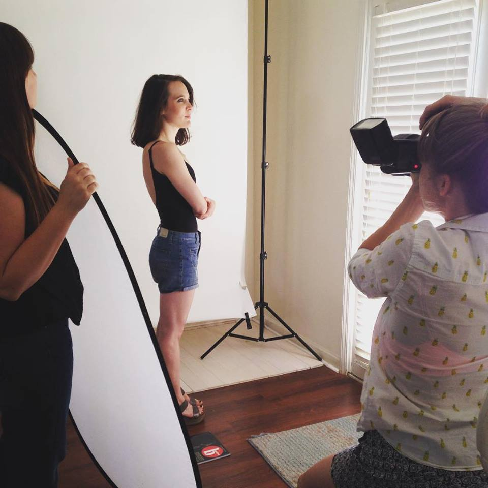 Rebecca Caine doing a photoshoot for