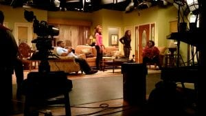 House of Payne set with 4 people sitting