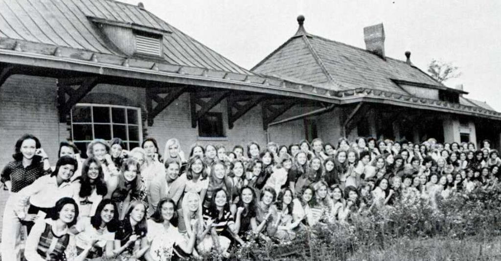Women in front of train shed