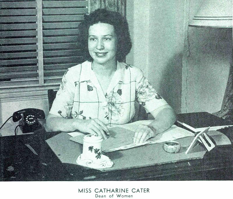 Dean Cater behind her desk