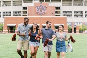 Four Auburn Fans in front of stadium