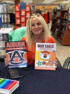 Darla Hall holding two books