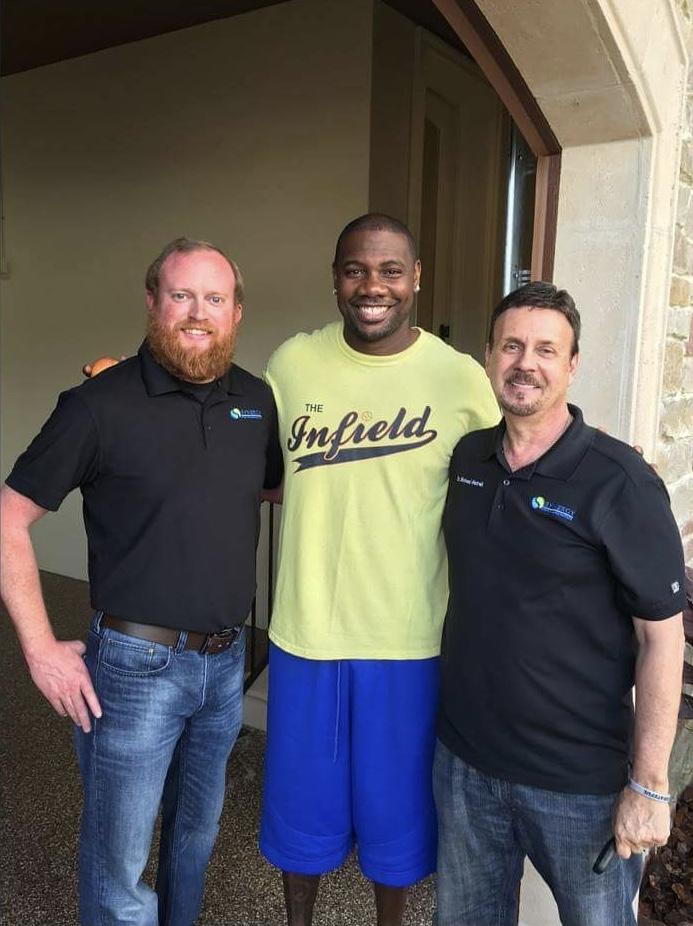 Trey Tucker and Dr. Hatrack with Philadelphia Phillies' Ryan Howard
