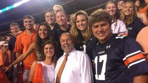 President Leath with students at a game