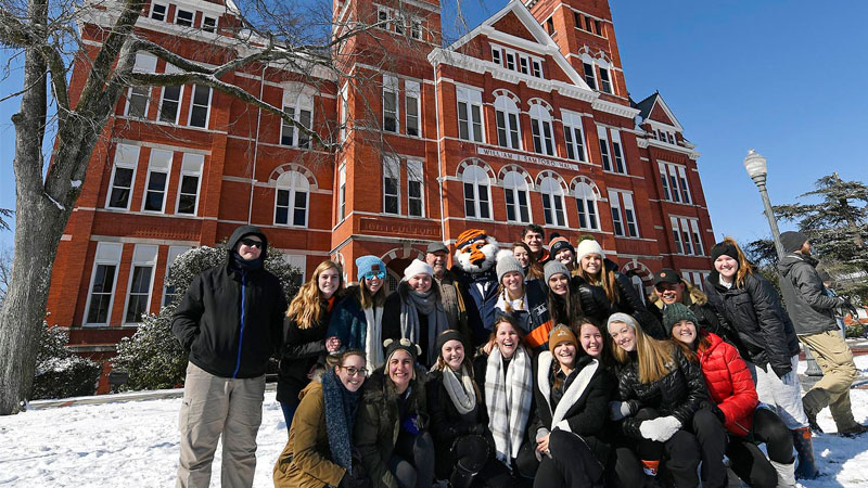 President Leath with students on a snow day