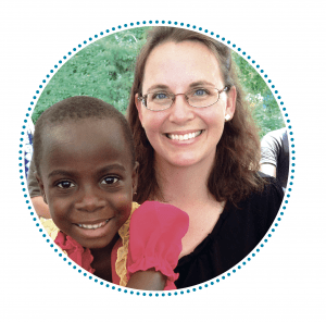 Sarah Wentworth '04 with Ugandan child
