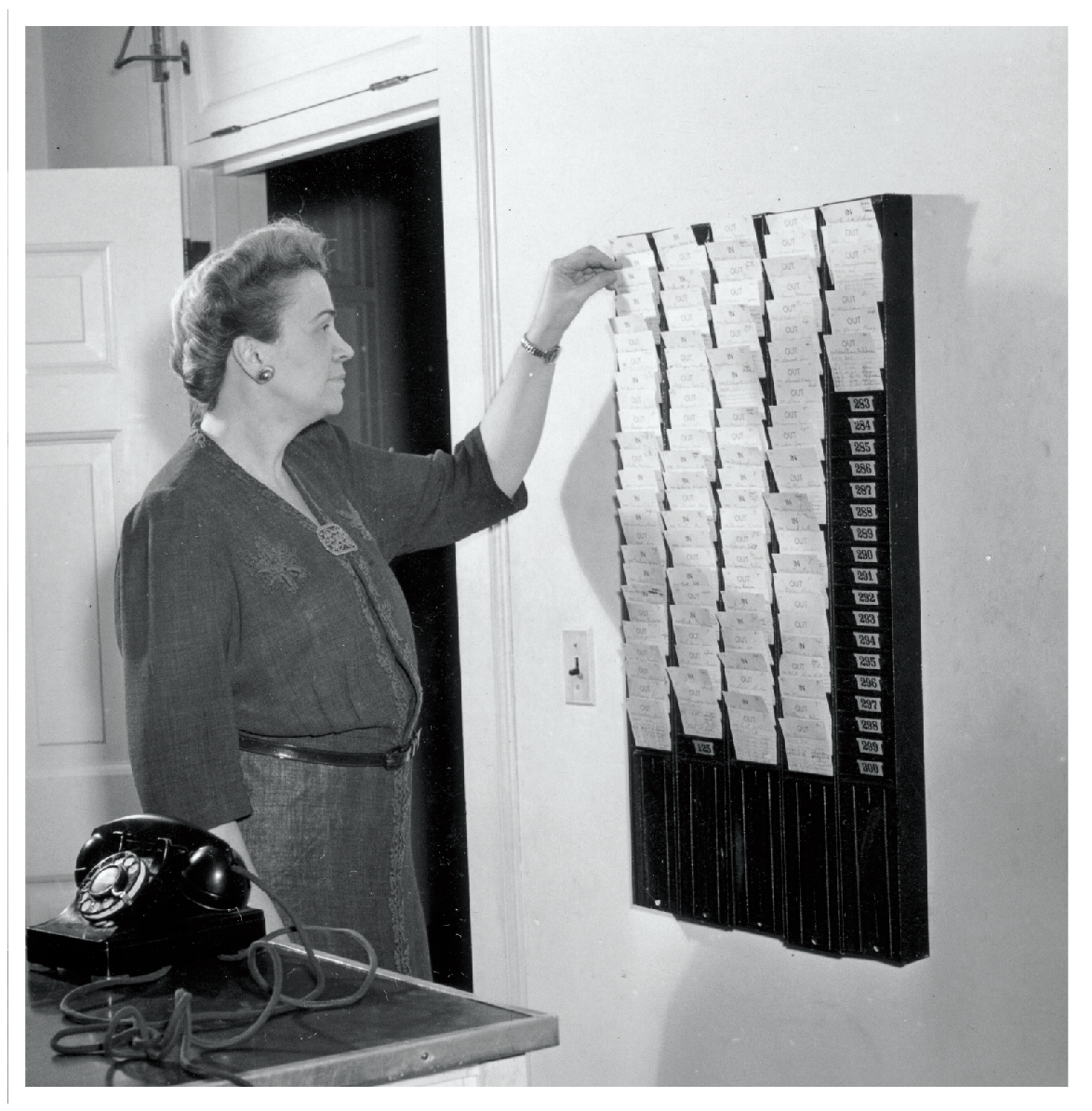 House mother reviewing date cards in 1946