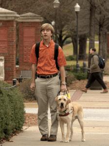 Tripp Gulledge '18 and seeing eye dog Dakota