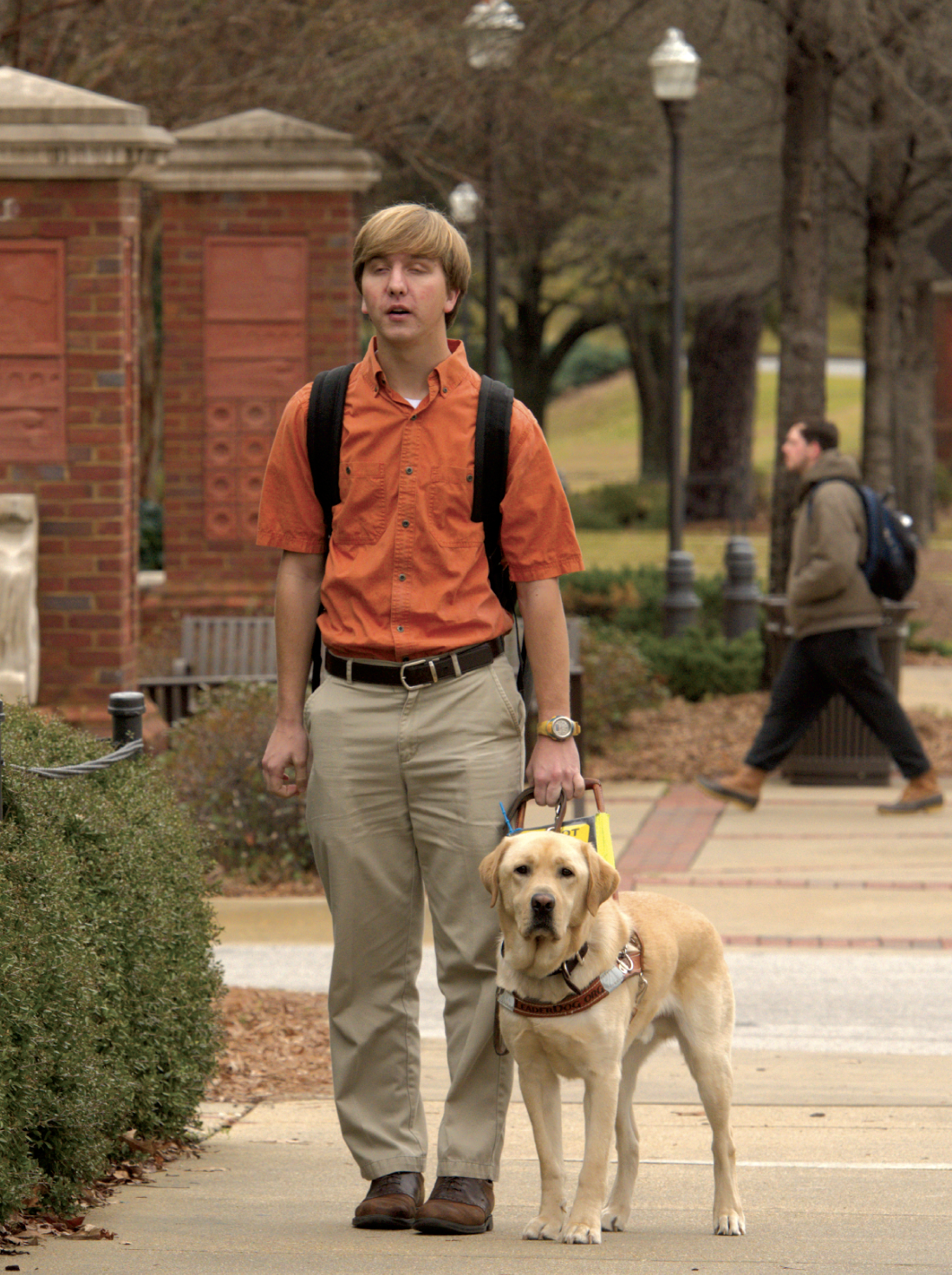 Tripp Gulledge '18 and seeing eye dog Dakota