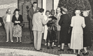 President Ralph Draughon, Caroline Draughon and Gov. Big Jim Folsom welcome guests at the president's home, 1950.