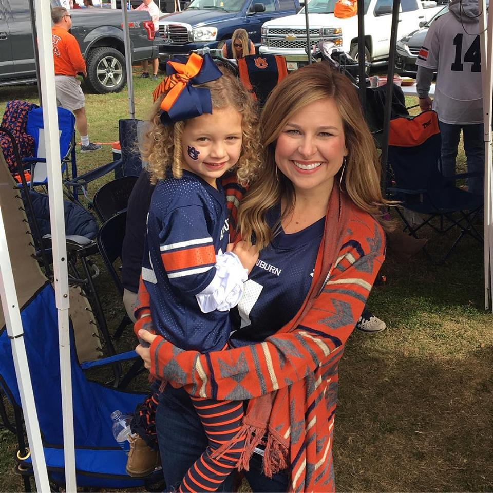 Kohn and her daughter cheer on the Auburn Tigers.