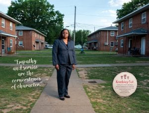 """Liz Huntley in her childhood neighborhood; """"Empathy and service are the cornerstones of character.""""; Reaching Out: Huntley, on a recent visit to her childhood neighborhood in Huntsville as well as a local school (on next page), stressed the importance of education to making a better life."""