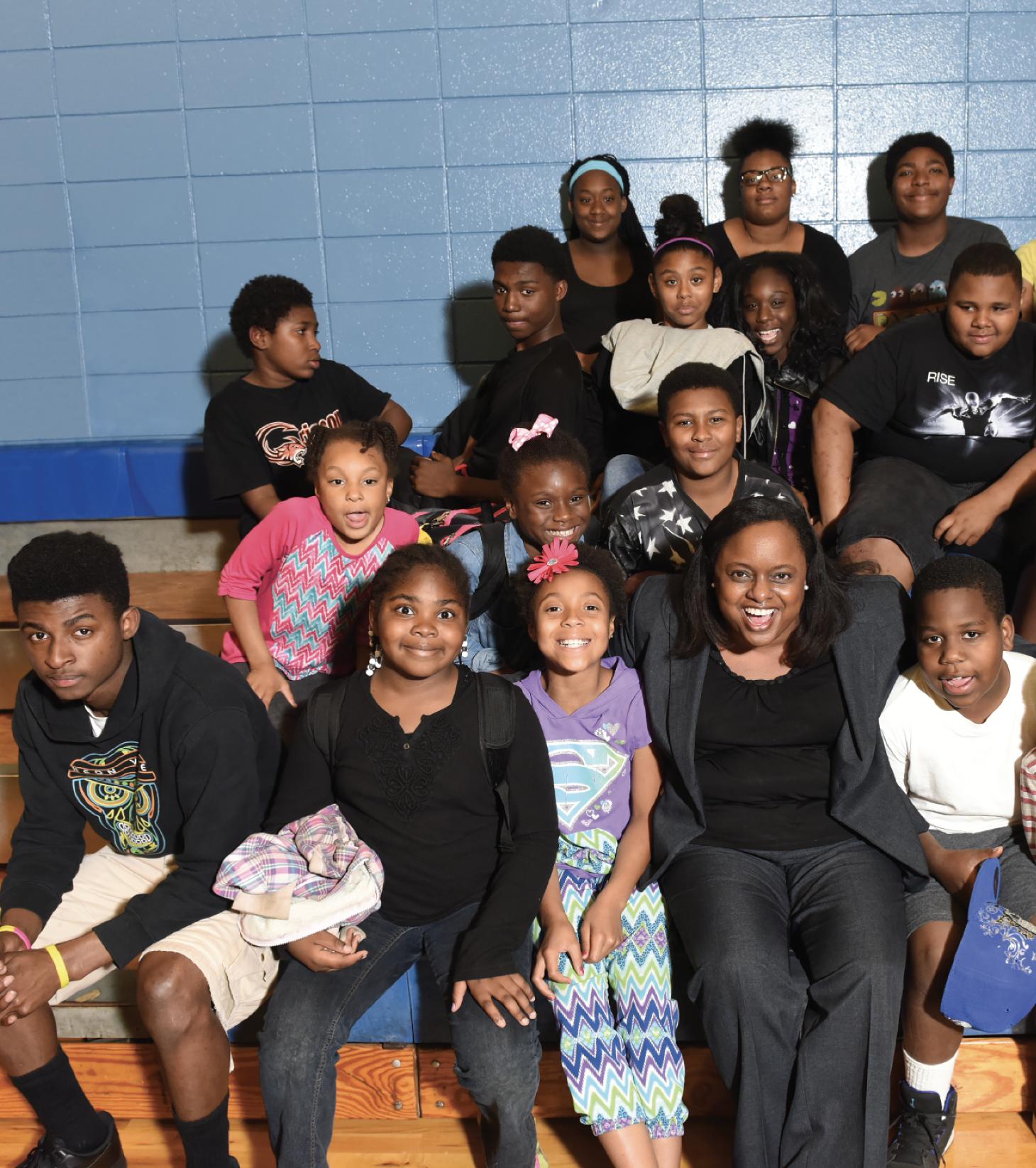 Liz Huntley with group of kids