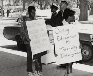 2 students protesting segregation in schools; Growing up in the volatile 1960s, Alverson remembers the South's social tension at that time. He says it helped shape the mindset he brings to his law practice and to his pageant coaching life.