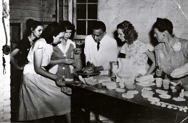 Hathaway teaches ceramics to a class of Auburn students.