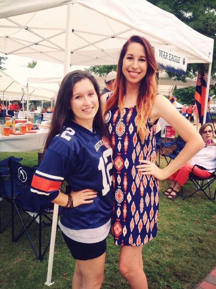 McIlwain with a friend at an Auburn football game.