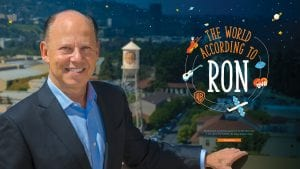 The World According to Ron; Whether he's across the country or on the other side of the globe, Ron Sanders '82 keeps Auburn close. By Amy Gary; photo of Ron in front of Warner Brothers tower