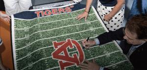 Gus signing rug