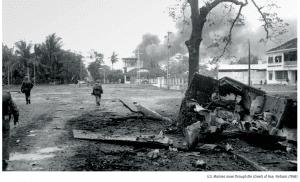 U.S. Marines move through the streets of Hue, Vietnam (1968)