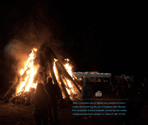 """When cold weather sets in, Mathan uses a backhoe to form a bonfire out of giant logs the size of telephone poles. Because of his background in heavy equipment, moving logs and running underground electricity and pipe is a """"piece of cake"""" for him."""