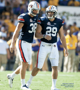 Daniel Carlson '16 (left) and Tyler Stovall '17 (right) share an exchange on the field.