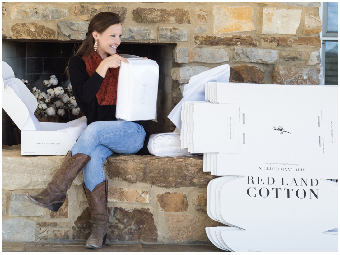 Anna Yeager Brakefield '12 with Red Land Cotton boxes