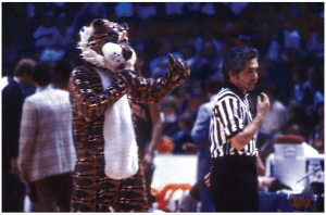 Aubie copying referee at a 1979 basketball game