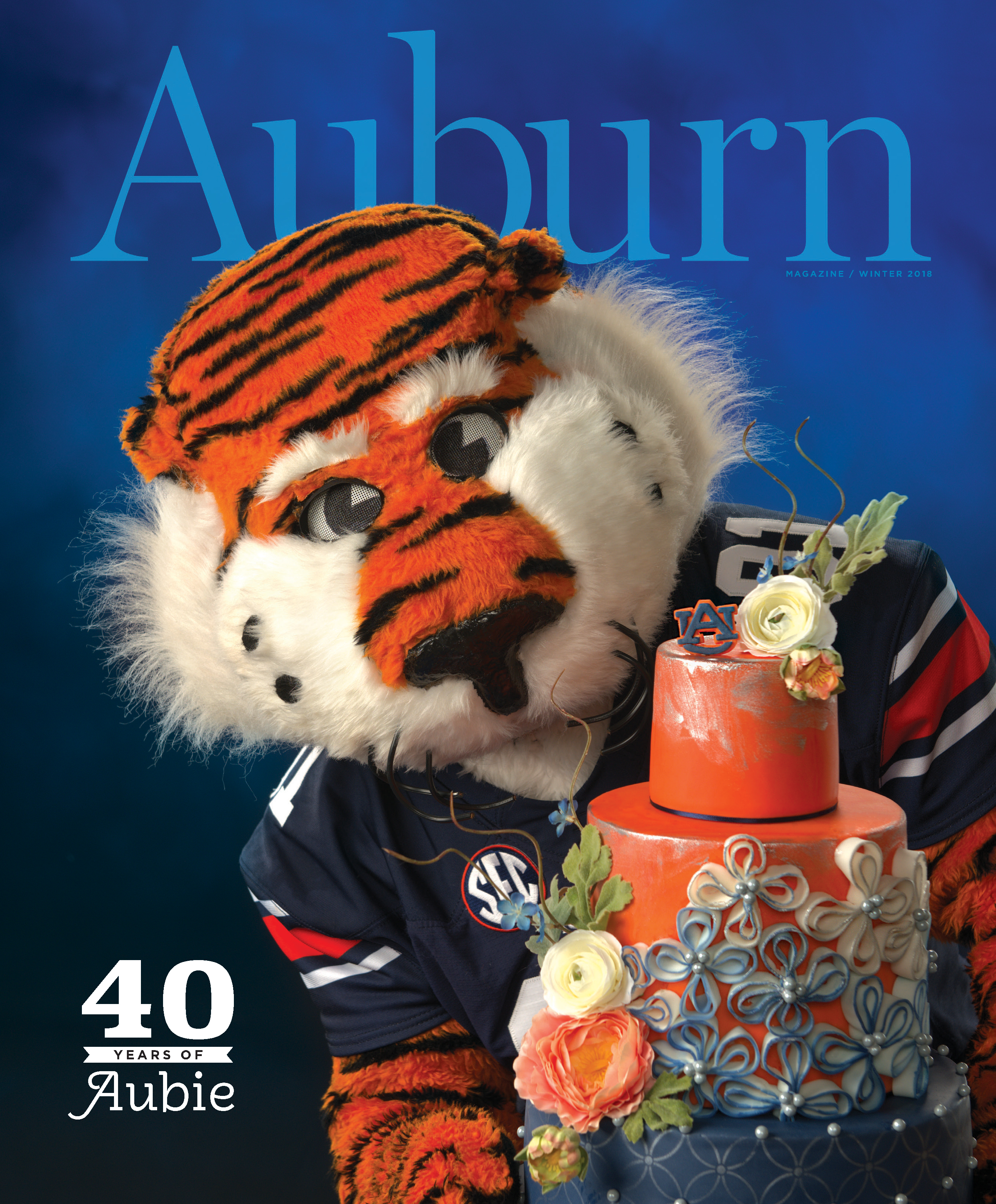 Auburn Magazine Winter 2018 40 Years of Aubie; Aubie holding a cake