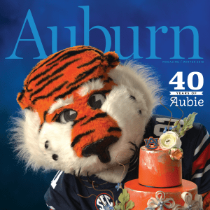 Auburn Magazine Winter 2018 40 Years of Aubie; Aubie holding a birthday cake