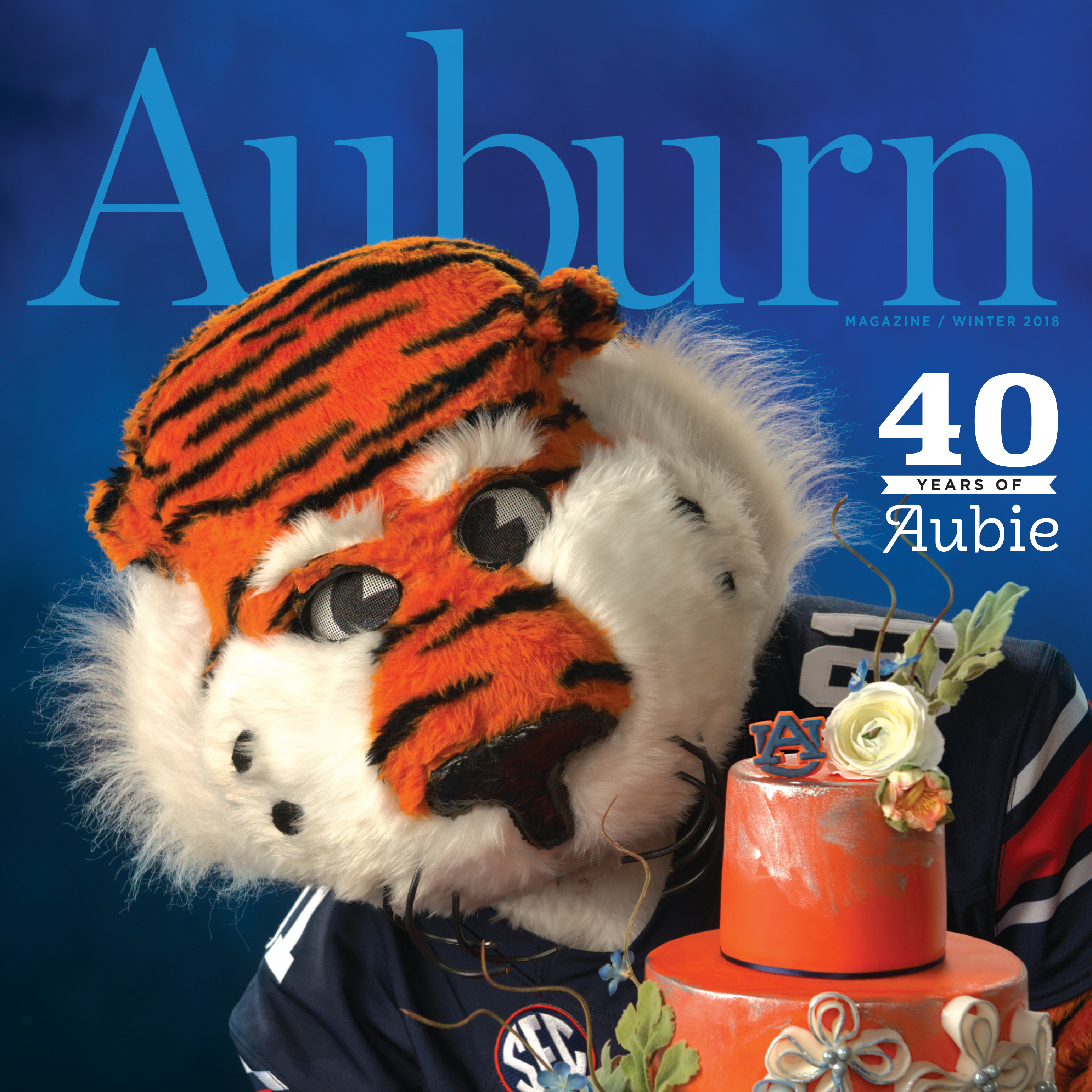 Auburn Magazine Winter 2018 40 Years of Aubie; Aubie holding a birthday cake