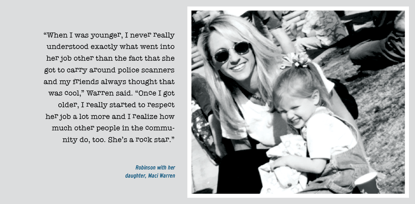 """""""When I was younger, I never really understood exactly what went into her job other than the fact that she got to carry around police scanners and my friends always thought that was cool,"""" Warren said. """"Once I got older, I really started to respect her job a lot more and I realize how much other people in the community do, too. She's a rock star.""""; Photo of Robinson with her daughter, Mad Warren"""