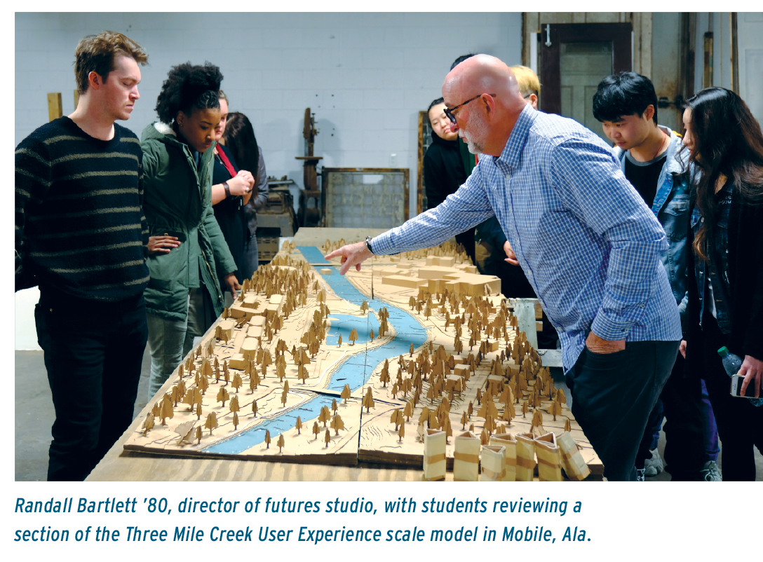 Randall Bartlett '80, director of futures studio, with students reviewing a section of the Three Mile Creek User Experience scale model in Mobile, Ala.