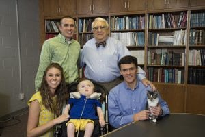 Auburn scientists developed a gene therapy treatment for GM1 gangliosidosis that is in clinical trials at the National Institutes of Health. Sara and Michael Heatherly of Opelika, Alabama, whose son Porter was the first known case of GM1 in Alabama and died in 2016, have been instrumental in bringing awareness to the disease. Pictured in a 2014 photo are, front from left, Sara Heatherly, Porter Heatherly, Dr. Doug Martin; second row from left, Michael Heatherly and Dr. Henry Baker, director emeritus of Auburn's Scott-Ritchey Research Center.