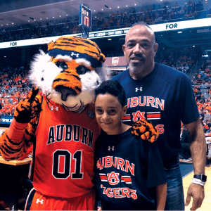 Toles and youngest son, Cinsere, with Aubie on March 2, 2019 at Auburn Arena watching the Tigers defeat Mississippi State 80-75.